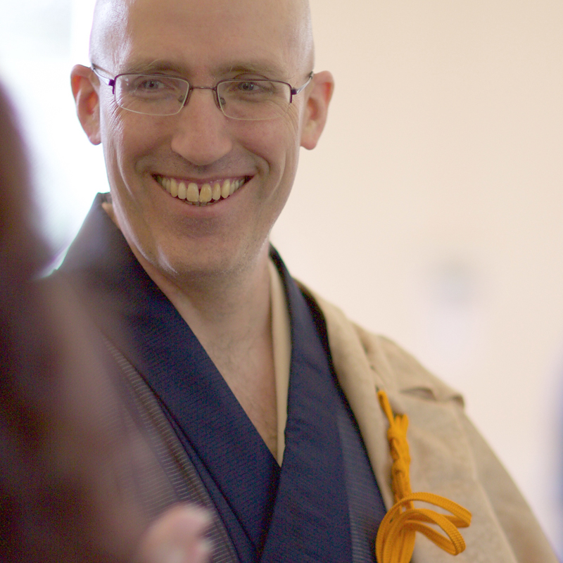 Koshin, wearing his dress robes and smiling