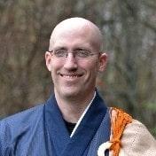 Koshin smiling and wearing Zen ceremonial robes