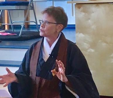 Genko gesturing during a dharma talk.