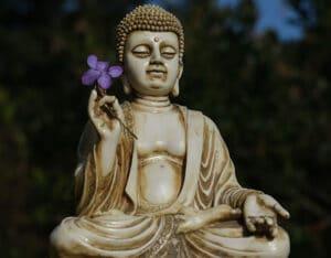 Buddha holding a flower