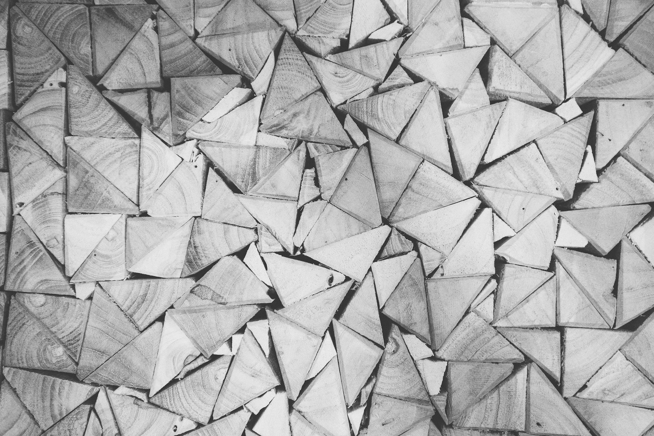 black and white triangles of wood in a pattern to symbolize deep listening
