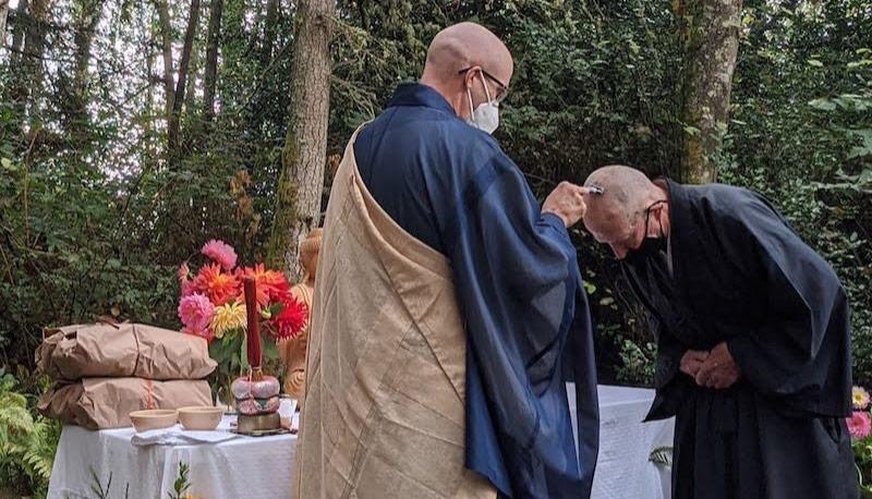 Koshin shaving the head of Anshin at Zen Ordination Ceremony