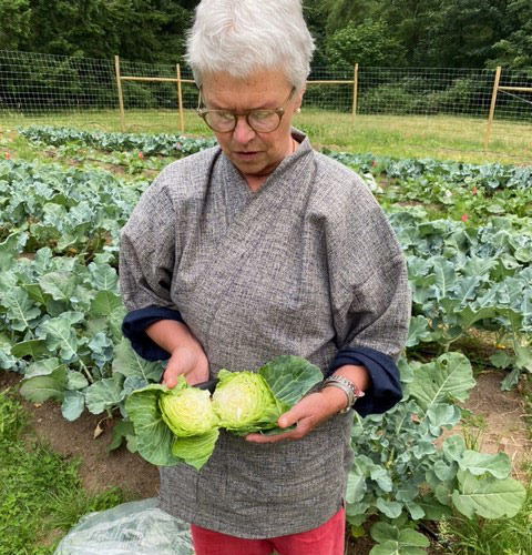 Zen Center member Shuko holding a cabbage for the food bank