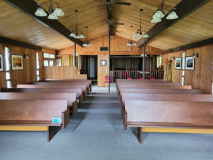 interior of our new home showing pews and wood paneling